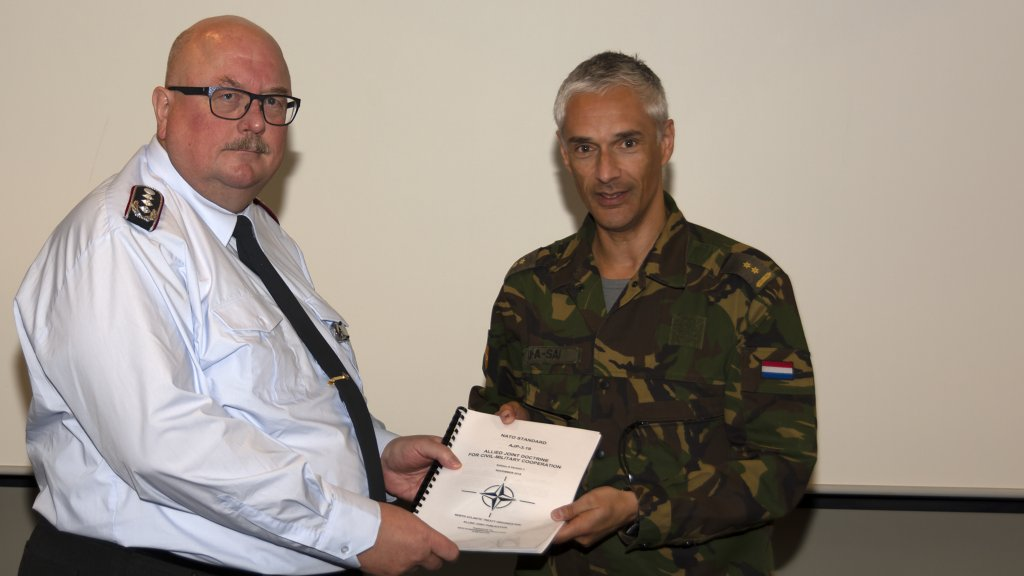 Allied Joint Publication for civil-military cooperation handed over to the Director CCOE